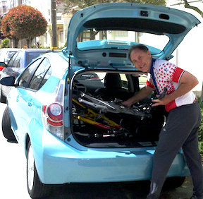 John Addison Loading Bikes in Prius C
